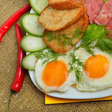 English breakfast - toast, egg, bacon, salad  and cucumber Royalty Free Stock Image