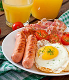 English breakfast - toast, egg, bacon and vegetables Royalty Free Stock Photo