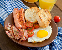 English breakfast - toast, egg, bacon and vegetables Stock Images