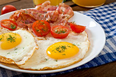 English breakfast - toast, egg, bacon and vegetables Stock Image
