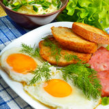 English breakfast - toast, egg, bacon and vegetables. Salad, cabbage, cucumber. Stock Image