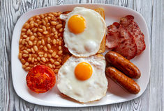 English breakfast with two eggs sausage beans Royalty Free Stock Photography