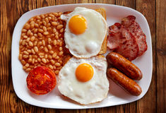English breakfast with two eggs sausage beans Royalty Free Stock Photo