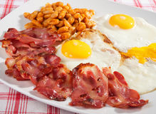 English breakfast. Typical English breakfast with fried bacon, beans and eggs Royalty Free Stock Photography
