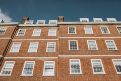 English building facade with orange bricks walls. Classic english residential building in a typical neighbourhood in England stock image