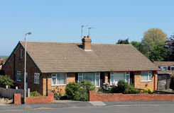 English bungalow houses. With flowery gardens in summer Stock Images
