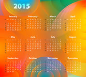 English Calendar for 2015 on abstract circles. Sundays first Stock Images