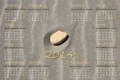 English calendar 2014 with stone on sand Royalty Free Stock Photo