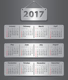 2017 English calendar_tablet. Calendar for 2017 year in English attached with metallic tablets. Vector illustration Stock Photos