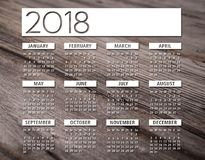 2018 english calendar wood background. 2018 white english calendar over woodden background Royalty Free Stock Image