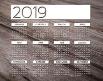 2019 english calendar wood background. 2019 white english calendar over woodden background Royalty Free Stock Photos