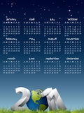 English calendar for year 2011. With Earth globe in grass Royalty Free Stock Photo