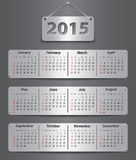 2015 English calendar. Calendar for 2015 year in English attached with metallic tablets. Vector illustration Stock Images