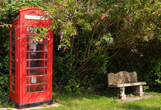 English call booth. English red call booth with stone bench Royalty Free Stock Photo
