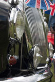 English car. Front of old english car, focus on lamp, lots of chromes Royalty Free Stock Photos
