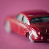 English car toy on fuchsia background Royalty Free Stock Photos