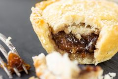 English Christmas Pastry Dessert Home Baked Mince Pie with Apple Raisins Nuts Filling. Nibbled with Visible Filling Texture. Golden Shortcrust Fork. Festive stock images