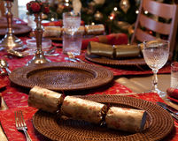 English Christmas table with crackers Stock Images
