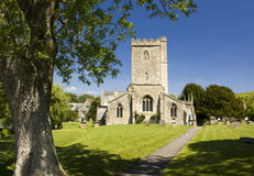 English Church. A village church in Wiltshire, England with freshly cut grass and blue sky Royalty Free Stock Photo