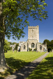 English Church. A village church in Wiltshire, England with freshly cut grass and blue sky Royalty Free Stock Photos