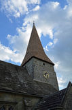 English church with oak shingle steeple and clock. Stock Photos