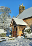 English church in winter. The small stone church at Cofton Hackett in snow, Worcestershire, England Royalty Free Stock Image