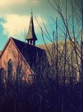 English Church in the Woods with Cloudy Sky and Trees royalty free stock photo