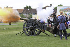 English Civil War Cannon. 17th Century cannon being fired at a battle re-enactment Stock Photos