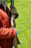 English Civil War Musket. English civil war flintlock musket rifle being held by a musketeer Royalty Free Stock Photos