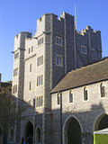 English college. The castle-like main tower at Lancing college, Sussex stock photo