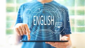 English concept with man using a tablet stock photography