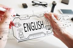 English concept with a notebook. English concept with man writing in a notebook stock photography