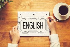 English concept with a person writing in a notebook