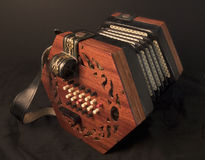 English Concertina. English 48-key Lachenal Concertina on black background Royalty Free Stock Images