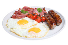 English Cooked Breakfast. Full English fried breakfast with roasted vine-tomatoes Stock Image