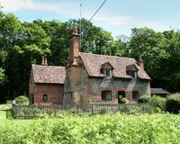 English Cottage. Brick and Flint Cottage set in an English Woodland Royalty Free Stock Photos