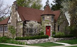 English Cottage in Evanston. This is a Spring picture of an English Cottage located in Evanston, Illinois in Cook County.  This one-story ivy covered brick house Stock Image