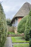 English Cottage and Garden. E view of an English cottage and garden, East Sussex, England, UK Royalty Free Stock Image