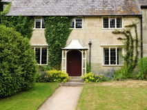 English Cottage and Garden. Exterior of an Old English Cottage and Garden Stock Photo