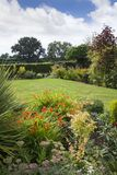 English cottage garden. English garden with lawn and flower beds, Worcestershire, England Royalty Free Stock Photo