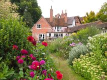 English Cottage Garden in Warwickshire. The Mill Garden, a typical English cottage garden in the historic town of Warwick Stock Photography