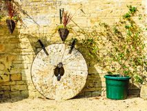 English cottage and old stone wheels Stock Photos