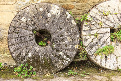 English cottage and old stone wheels Royalty Free Stock Image