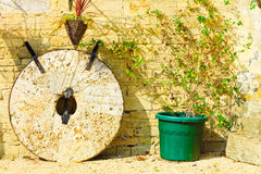 English cottage and old stone wheels Stock Photography