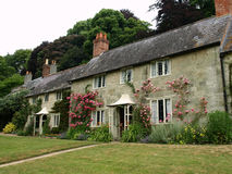 English Cottages. Row of Traditional English Cottages and Gardens in the Cotswolds - Built Mid 19th Century Royalty Free Stock Photography