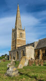 English Country Church with Graveyard and Tall Spire on Summers Stock Photo
