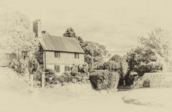 English country cottage West Sussex, vintage effec Royalty Free Stock Image