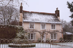 English Country Cottage in the Winter Snow Stock Image