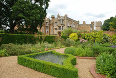 English Country garden. Formal gardens at an English country house stock image