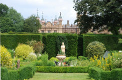 English Country garden. Formal gardens at an English country house stock images